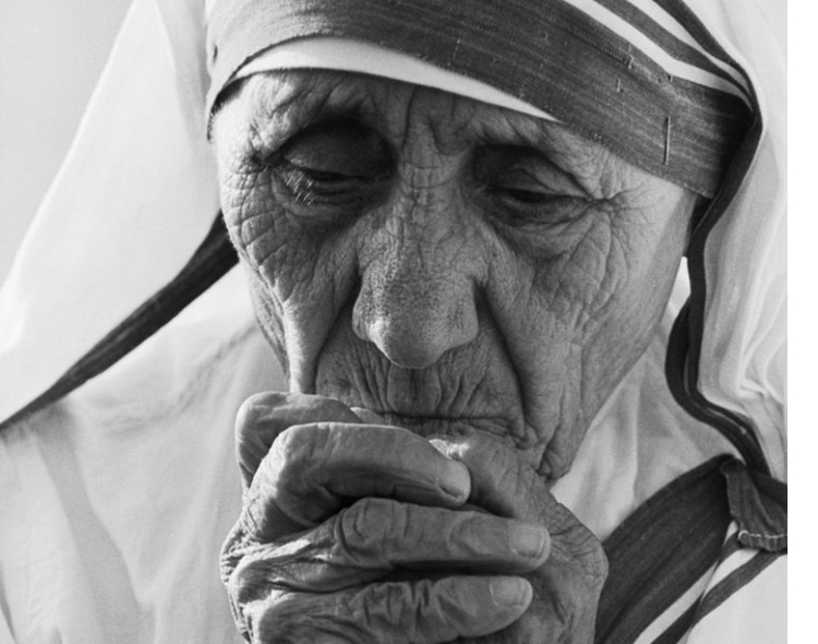 Original Caption: 7/01/1988-Tijuana, B.C.,Mexico-  Mother Teresa, 77, 1979 Nobel Peace Prize winner praying during dedication ceremonies at her 400th world wide mission to care for the poor. The Tijuana mission will shelter the homeless, the terminally ill and unwed mothers.